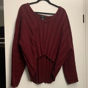A cropped high low maroon sweater